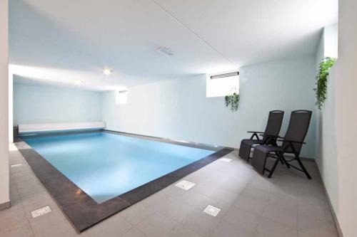 vakantie vieren in een huis met prive zwembad Limburg
